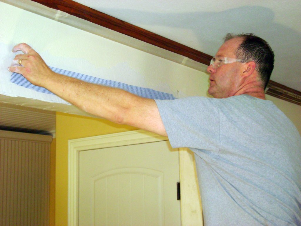 Applying mesh to corner plaster repair