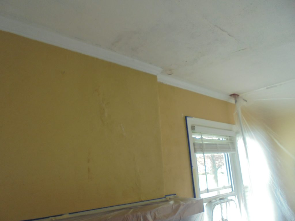 Before: bubbles and bulges on the walls and ceilings. Time to see what's under the surface.