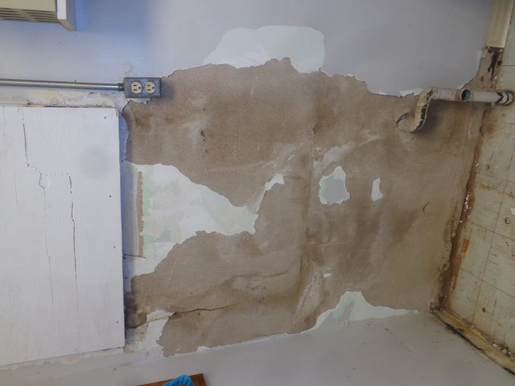 Before: old plaster removed and surface prepped