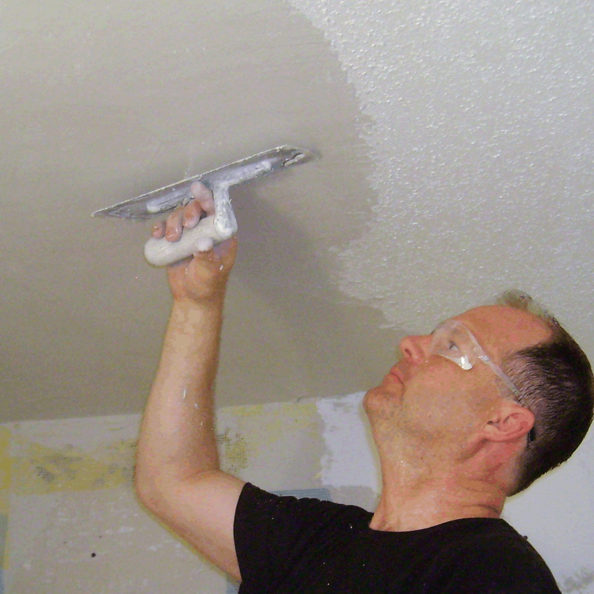 Plasterman working